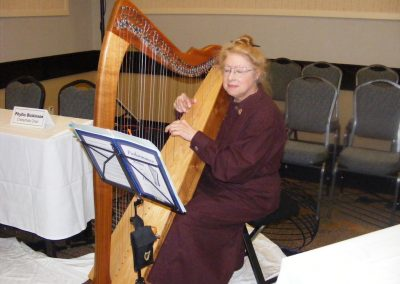 Nellie Brown from the Buffalo Club provides music for the memorial.